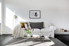 couch draped / coffee tables