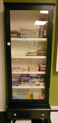 Gun Cabinet ~ Now a Fabric Chest....Love this idea ~ Fabric at a glance....
