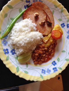 Smoked Turkey flavoured with Burnt Garlic served with Ginger Basa, steamed Rice and Beans.