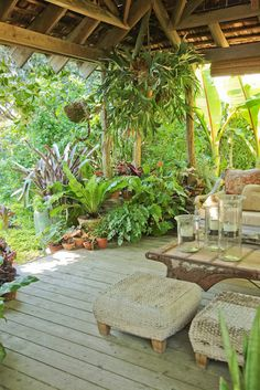 Fortnam Gardens: Landcraft Environments -- Such wonderful lush plantings in the corner of this Tiki Hut, hardscaping, patio, backyard oasis, container gardening, staghorn fern