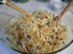 Oriental Coleslaw Recipe:  1 c sunflower seeds (plain)   2/3-1 c slivered almonds (plain)   2 pkg chicken ramen noodles w/ seasoning pks  1 pkg coleslaw (any type)   1/2 c vegetable oil  1/4 c sugar   3 Tbsp white vinegar