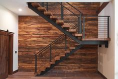 Black onyx rod railing pops against these warm hickory stair treads and wooden backsplash.