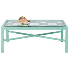 "A geometric motif peeks through the glass top of the pale turquoise Winter Harbor coffee table, a stylish spot to rest a drink or a plate of hors d'oeuvre. With a durable powder coated finish, this versatile Worlds Away piece is perfect for indoor and outdoor entertaining.  45""W x 20""D x 18""H"