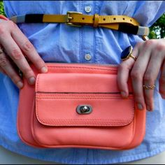 Coral Faux-Leather Wristlet Coral pink faux leather Wristlet has front pocket, a slip pocket in the back and a zip top. Merona Bags Clutches & Wristlets