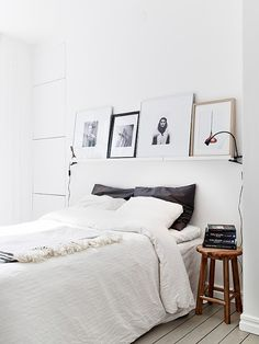 spare bedroom idea - stool for bedside table, clip lamps, shelf