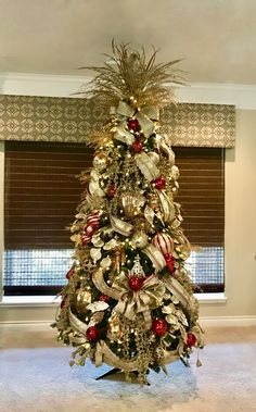 Beautiful champagne gold fancy ribbon for the Christmas tree. Designed by Arcadia Floral and Home Decor.