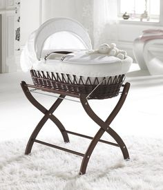 That is it! my next baby will have a Moses basket and stand in my room instead of a bassinet! I love these!