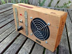 Hand made (from cigar box) amp. See the etsy site for cigar box ukuleles. DIRT AMP - 130447