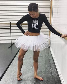 Great for ballet warm ups or barre fitness workouts. Show off your awesome dancer body with this tight, leotard-like, cropped tee. These run small and are super stretchy so they work for girls and lad