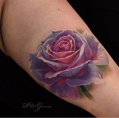 Beautiful realistic rose tattoo
