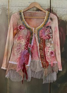 Whimsy soft vintage viscose jersey jacket, hand dyed in uneven shades of cream, blush, red, pink, sand..Reworked with colorful intricate details. Hems adorned with antique laces- hand embroidered net ( tambour) hand dyed lingerie laces, vintage silk trim with metallic thread embroidery,