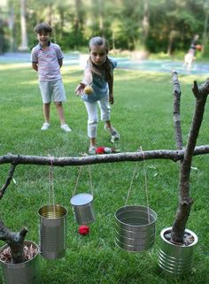 Another fun game that is easily made is can toss! Take a few old food cans, some twine or string, and some sticks. Finding the sticks will be part of the fun if your kids are anything like mine (she loves looking for a good stick!). #DIYbackyardgames