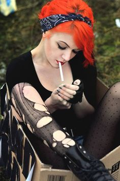 orange hair and gutter goth. love it! hate the cigarette though.