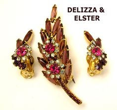 Pink and purple blooming flower pin with earrings.