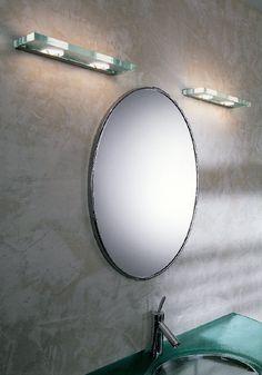 Jek 1 - P Parete Lung. 17cm 1 luce  Lampada da parete della collezione JEK disegnata da Andrea Pamio nel 2001 e composta da una struttura in metallo e diffusore in cristallo extrachiaro trasparente. Lunghezza 17cm
