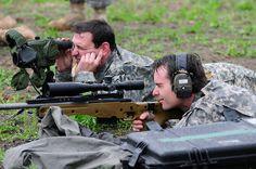 Jeff Gordon shoots sniper rifle