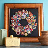 Felt wreath, should be easy to DIY, I like some blanket stitching, but not on every circle, also, I would felt the pieces onto the backing with a felting needle, this could be a perfect first felting project for me.
