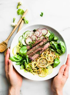Quick apple kimchi salad with sesame beef! This Asian inspired spiralized apple salad recipe makes a quick and healthy kimchi substitute. Cucumber and Apple spiralized noodles tossed in a spicy kimchi style salad dressing and served with sesame beef. A light nourishing meal that's ready in 30 minutes. Paleo withWhole 30 options.#paleo #whole30 #salad #lowcarb