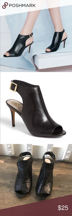 """Vince Camuto Nissah Bootie PLEASE SEE PICS FOR CONDTION  A bold heel cutout adds a hint of edge to the clean, modern silhouette of a peep-toe bootie. 3 1/2"""" heel Adjustable strap with buckle closure. Leather upper and lining/synthetic sole. Vince Camuto Shoes Ankle Boots & Booties"""