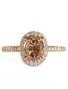 Rose gold & champagne diamond halo engagement ring.
