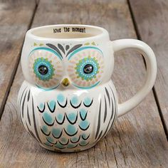 "Love The Moment Folk Owl Mug - Whoooo doesn't love our owl mugs?? We sure do, so we made some in adorable folk art designs! Generous 16-ounce ceramic mug in a fun owl shape, with a colorful face and turquoise and charcoal-colored feathers. ""Love The Moment"" lines the inside of the rim, and it's dishwasher and microwave safe, making it the perfect everyday mug!"