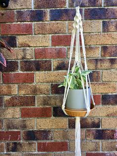 Handmade macrame cotton hanging basket shelf made using 100% natural cotton. This is perfect to place your plants, candles or ornaments onto. Basket INCLUDED in price. Pot/plant not included. Please feel free to ask any questions you may have about this item. As each item is made to order, there may be some tiny variattions when compared to these photos.