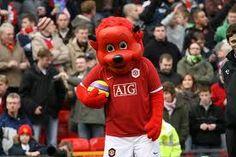 Mascota del Manchester Utd - Fred El Rojo - Un diablito con cuernos y cola puntiaguda.