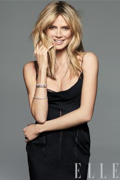 Heidi Klum wears a silk crepe slipdress from Calvin Klein Collection, a white gold and diamond openwork bracelet from Bulgari, and diamond bangles from Tiffany & Co.
