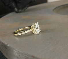 Yellow gold ring with emerald cut moissanite stone. Emerald Cut Moissanite, Moissanite Rings, Yellow Gold Rings, Wedding Rings, Engagement Rings, Jewels, Stone, Enagement Rings, Rock