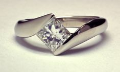 Princess Cut 1.00ct.  Diamond set in 18KT White Gold Solitaire Ring, a Copyrighted Original by Thomas Michaels Designers, Inc.