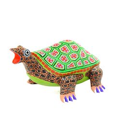 Delightful turtle wood carving by Lauro Ramirez.