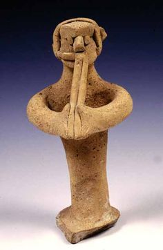 Terracotta Figurine playing the double flute.Cyprus