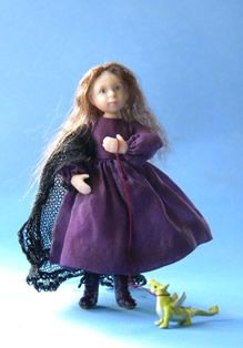 A standing doll with 4 joints dressed in purple silk with matching leather boots.The pet baby dragon adds to the Gothic theme.