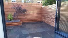 Fence idea. Great as this can cover existing fence for minimal cost and maximum impact. Clean lines look pleasing. Garden Privacy Screen and Trellis London.