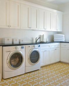love this simple, white, traditional laundry room with colorful, bold tile floors | by Ellen Grasso Inc