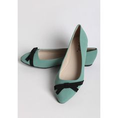 Cute and versatile, these dusty mint green shoes feature a cute, off-center black bow at the toe. Finished in a neoprene vegan leather material, these adorable…