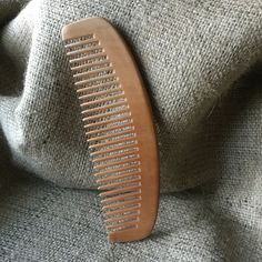 One of a kind full size Peachwood comb. Sturdy and damn reliable....just like…