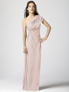 This beautiful chiffon Dessy bridesmaids dress drapes effortlessly from the one shoulder detail to the floor. Style 2858 has a hidden zipper in back.