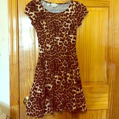Leopard skater dress Washed once but never worn. Perfect condition. Size small. Dresses Mini