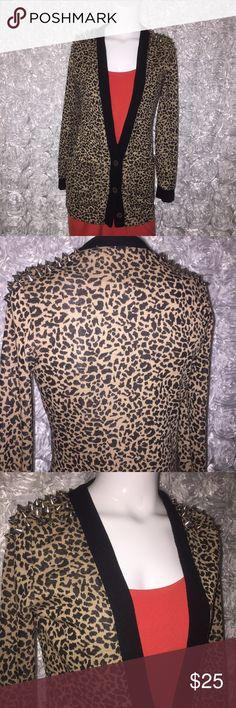 Reverse leopard print cardigan, studded shoulders Awesome animal print cardigan with black edges and silver stud embellished shoulders. This piece is a head turner! EUC  Orange dress not included but also available in my closet :)  https://poshmark.com/listing/Cute-orange-and-black-Ann-Taylor-dress-with-belt-595463c5fbf6f93f870066fc Reverse Sweaters Cardigans