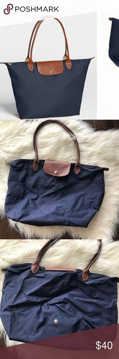 PRICE FIRM Longchamp Le Pliage large tote Authentic bought in London. It has been loved please see all the pictures. Just a little bit dirty in some spots because it has been worn a lot and has few tiny pulls. Still pretty good condition. NO TRADES Longchamp Bags