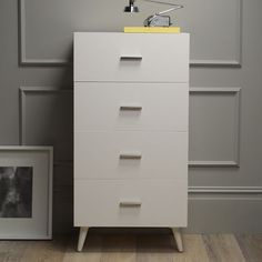 """ADAMS 4-DRAWER DRESSER  $399.00 SPECIAL $279.00  Store more. With its clean lines, tapered legs, brushed-nickel hardware and roomy drawers, the Adams Dresser offers tidy and streamlined storage. Use it to corral all the bedroom's odds and ends.    • Solid wood legs; engineered wood frame.  • Lacquered finish.  • 23.5""""w x 15.75""""d x 46""""h.  • Metal hardware with brushed-nickel finish.  • Four drawers open on smooth metal glides.  • Round tapered legs.  • Assembly"""
