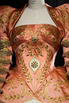 The bodice of one of Julia Roberts costumes. I'd say Renaissance more than anything else. From the movie Mirror, Mirror. One of the Queen's gowns.