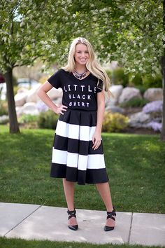"""Who needs a little black dress when you can have a little black shirt? What is so fun about this tee is that you can dress it up (like we did) or go casual with your favorite jeans. Great quality. 96% Rayon. 4% Spandex. Model is 5'7"""", a 32C, and is wearing a size small."""
