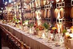 Big long table IN the aging room of a winery?! Love doesn't even begin to describe my feelings for this picture.