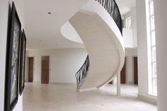This floating steel supported Moleanos staircase is able to execute a beautiful curved shape in our clients property in Hampshire.