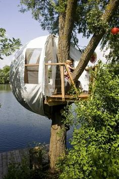 Awesome! A tree house tent that can be pulled back to see the view, and then closed at night.