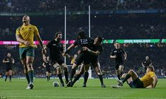 Ma'a Nonu is mobbed by his New Zealand colleagues after scoring their second try of the match early in the second period