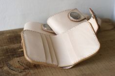 Corter Leather ~ Basic snap wallet in natural leather with one of an assortment of coin conchos