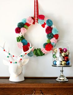 Pom Poms are IN! Check out 17 fabulous DIY projects to make with pom poms, like this cute wreath!